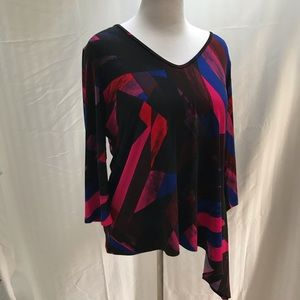 Clara Sun Woo asymmetrical top in pinks and blues